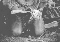vertical-shot-male-down-his-knees-reading-bible-black-white-vertical-shot-male-down-his-knees-164551445